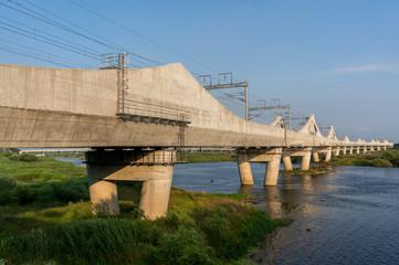 Korean railway bridge over a river.
