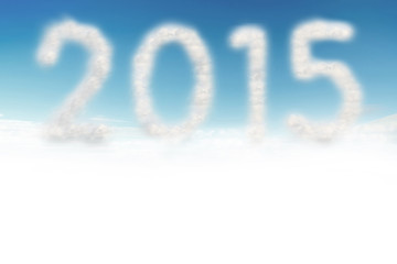 Cloud in blue sky with a shaped of number 2015