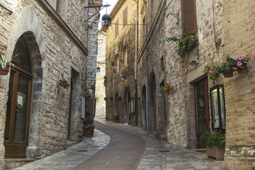 Narrow stone street in a town from Tuscany