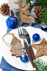 Christmas table setting with wooden decorations