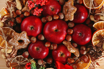 Christmas apples, nuts and cookies close-up