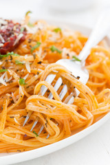 pasta with tomato sauce and parmesan cheese, close-up, vertical