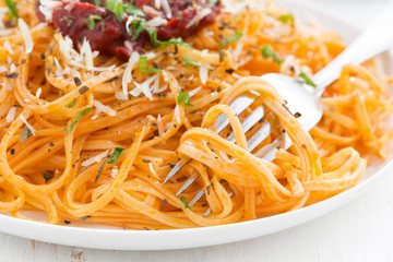 pasta with tomato sauce and parmesan cheese, selective focus