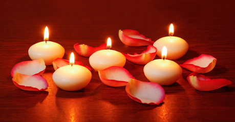 Petals of roses and candles