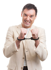 angry man in handcuffs
