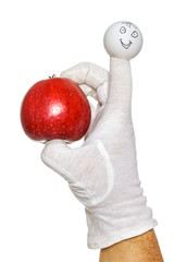 Happy finger puppet holding red apple