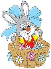 Easter Bunny in a basket with flowers