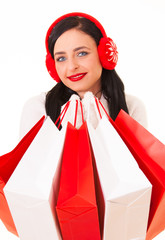 Charming young woman with shopping bags