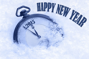 Pocket watch in snow, Happy New Year 2015 greeting card