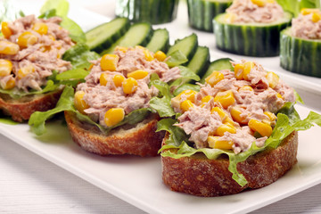 Sandwich with tuna and corn on white background