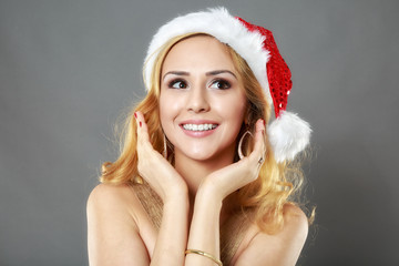 beautiful blonde girl in a gold dress and hat ready for Christma