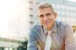 Leinwandbild Motiv Satisfied Mature Businessman