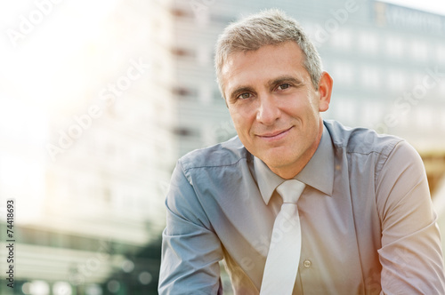 Satisfied Mature Businessman poster