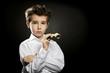 Little snobish boy with theater binoculars