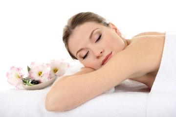 Beautiful young woman having relax in spa salon
