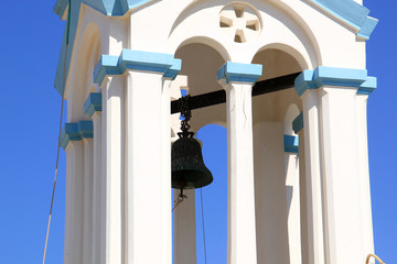 Blue and white bell tower with columns on Greek island