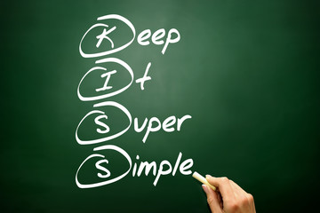 Keep It Super Simple (KISS), business concept on blackboard