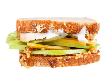 Turkey, cheddar, and green apple sandwich. Isolated on white