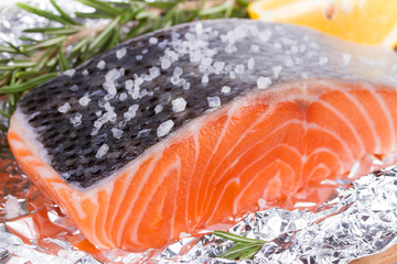 Fresh salmon ready for cooking on the foil paper