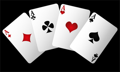 Four aces of different cards on a black background