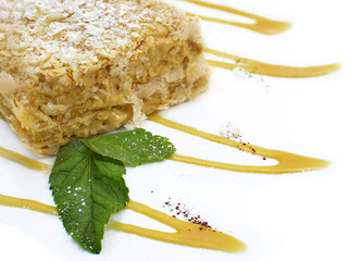 Napoleon cake with mint leaves and syrop