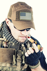 PMC contractor smoking a cigar
