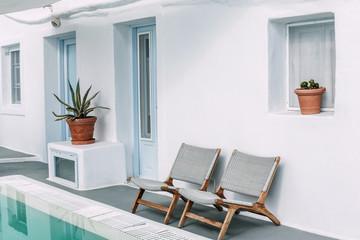 Two chairs near the pool in Santorini, Greece.