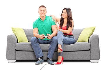 Girl watching her boyfriend play video game