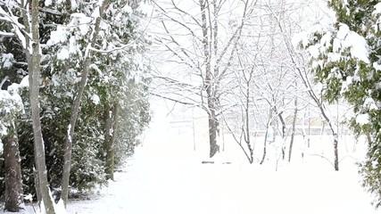 Snow falling diagonally on white snowy background