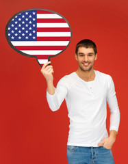 smiling man with text bubble of american flag