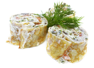 Fish salad in pancake rolls isolated