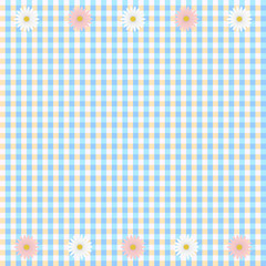 Blue plaid background with white and pink daisy flowers