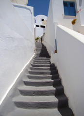 Narrow streets between houses with stairs, Santorini
