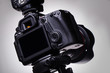 DSLR camera on tripod - 74430609