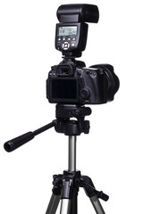 DSLR camera on tripod with external flash