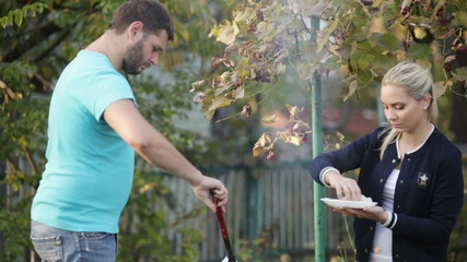 Couple make meat in barbecue
