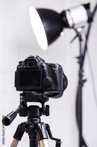 DSLR camera on tripod - 74430631