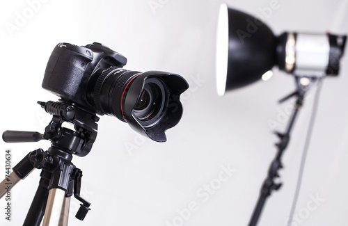 DSLR camera on tripod - 74430634