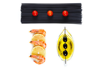 top view of a shrimp with lemon and pasta with tomatoes