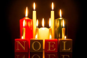 NOEL candles black background