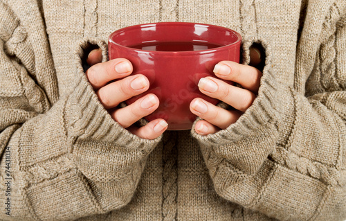 canvas print picture Female hands with hit drink
