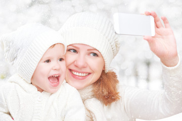 selfie  in winter. happy family mother with daughter and photogr