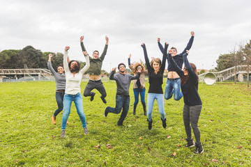 Multiethnic Group of Friends Jumping Together