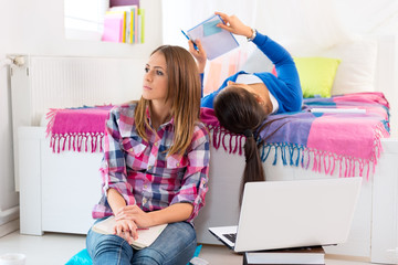 Two female students learning at home
