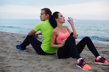Woman refreshing with bottle of water exhausted after run