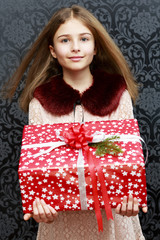 Christmas gift - lovely girl with christmas present