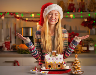 Portrait of happy girl in santa hat with christmas cookies