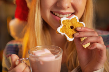 Closeup on teenager girl drinking cup of hot chocolate