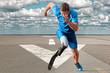 Athlete running runway