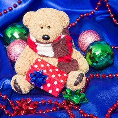 Charming small teddy bear with Christmas gift